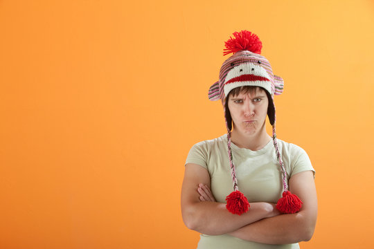 Upset young Caucasian woman in Monkey Cap