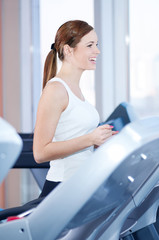 Young woman at the run at gym