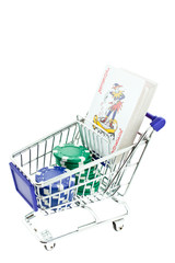 poker chips and playing cards deck in shopping trolley