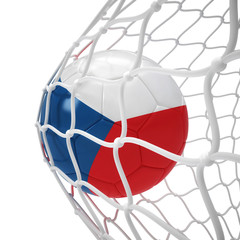 Czechian soccer ball inside the net