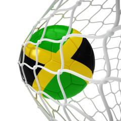 Jamaican soccer ball inside the net