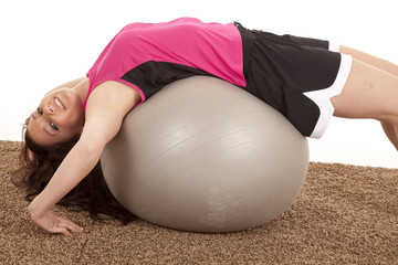 Woman fitness ball back happy