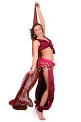 Beautiful young belly dancer with a veil