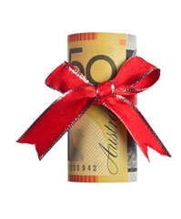 Fifty Australian dollars wrapped by ribbon isolated on white