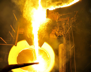 Molten hot steel pouring.
