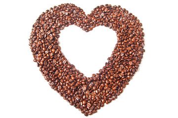 Heart from brown coffee beans on white background