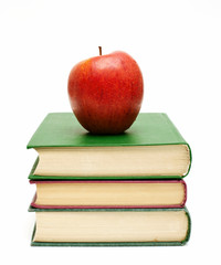 red apple on a book stack