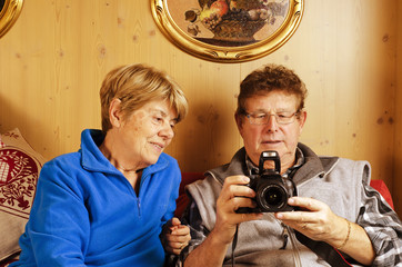 Senior Couple wathcing Pictures on the Camera