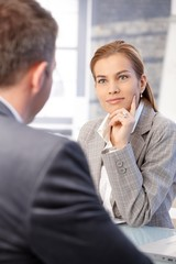 Businesswoman interviewing male applicant
