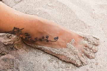 Piede nella sabbia