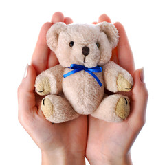 Caring hands holding a toy