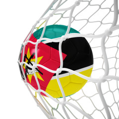 Mozambican soccer ball inside the net