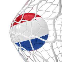 Netherlandish soccer ball inside the net