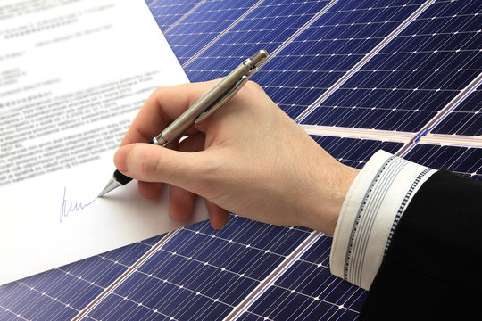 Signature of Business Contract in front of Solar Power Station