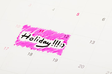 Calendar marked as holiday with pink highlight