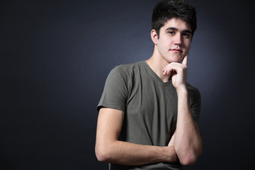 Young attractive happy man possing in studio.