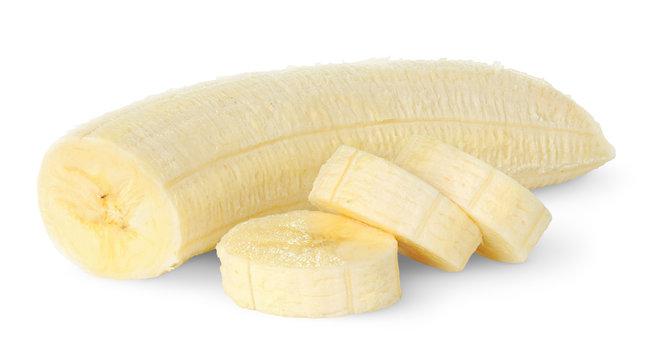 Isolated banana. Peeled banana slices isolated on white background