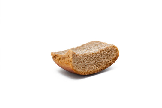 A piece of stale bread on a white background