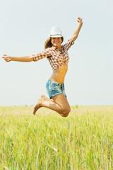 Jumping girl  at field