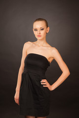 Elegant  girl in black small dress