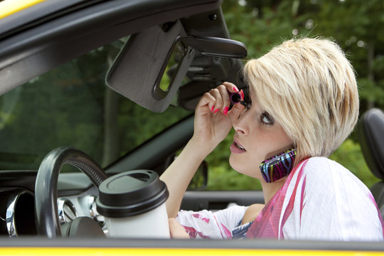 Barbie distracted while driving
