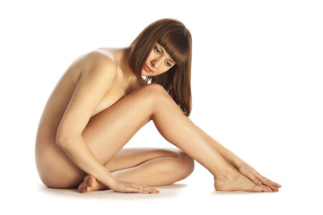 Naked beautiful woman in sitting on the floor