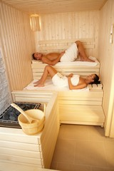 Man and woman in sauna