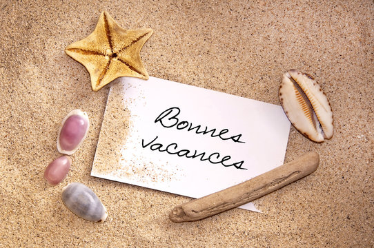Message bonnes vacances, sable et coquillage