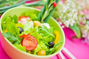 bowl with a salad on the table