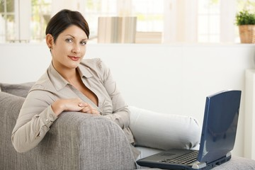 Woman browsing internet at home
