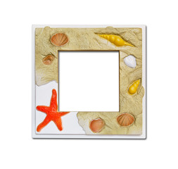 Frame of sea shell and stones