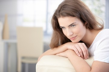 Beautiful woman resting on sofa smiling