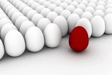 red easter egg among similar white eggs