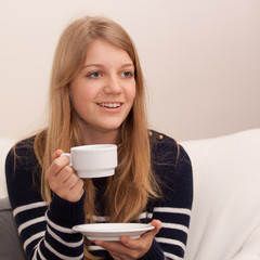 Young lady drinking hot drink
