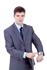 man looking and pointing at his watch