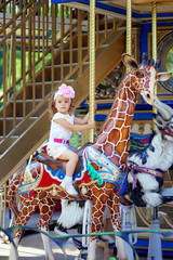 Girl riding on a carousel