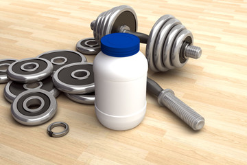Arrangement with dumbbells and a jar of protein