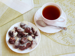 Tea with sweets in the shape of seashells
