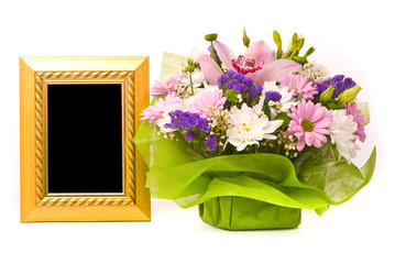 Beautiful bouquet and golden frame on a white