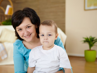 mother and son at home on the floor