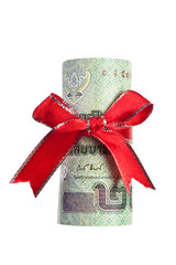 Thai baht wrapped by ribbon isolated on white background
