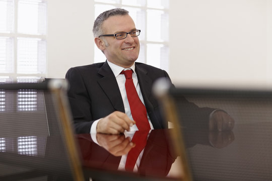 Businessman in corporate meeting