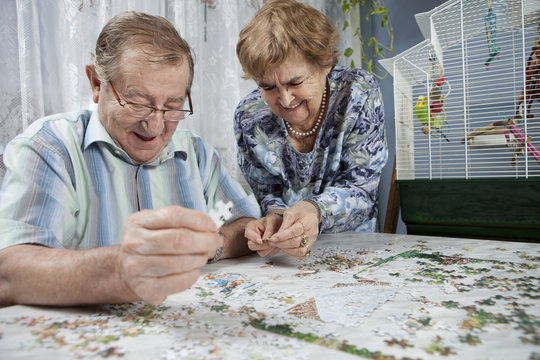 Senior couple working on a puzzle
