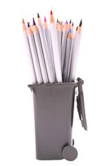 Pencils in trash bin