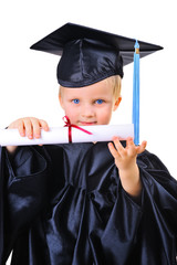 Cute little boy in graduation gown receiving diploma