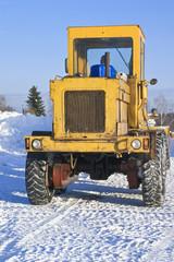 Fototapete - Big tractor on snow