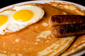 Pancakes, eggs and sausage breakfast