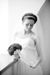 Studio portrait of beautiful stylish bride