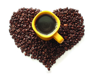 coffee beans and a yellow cup