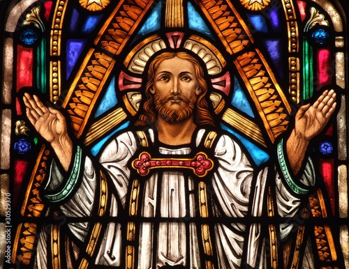 Stained Glass Window Of Jesus With His Hands Up